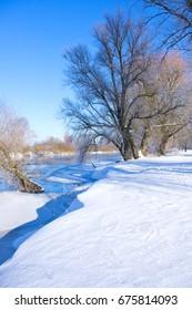 Winter river in sunny day