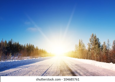 Winter road in deep forest. Sunny frosty january. Noth Mountines. Murmansk.