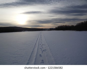 Winter road on the river