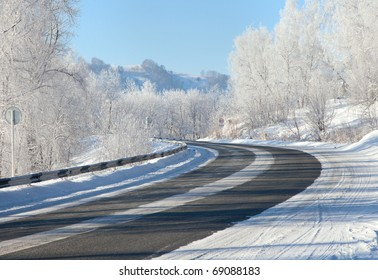 Winter road. Snow and ice complicates the movement and shooting