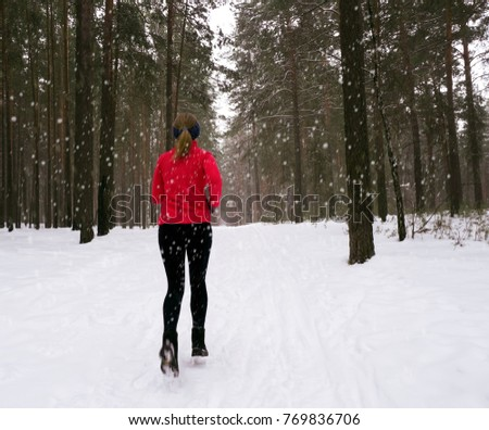 4e39ab36 Winter running exercise. Runner jogging in snow. Young woman fitness model  running in a