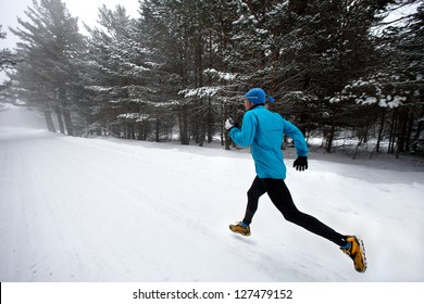 Winter running in a mountain road