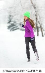 Winter running woman in snowy winter morning. motion, soft daylight
