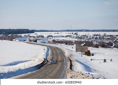 Winter rural landscape with road and forest, Russia