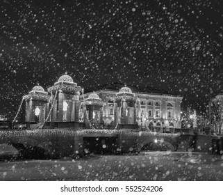 Winter in Russia. Christmas background : Saint Petersburg at winter evening. Lomonosov bridge. Vintage colored picture. X-mas, New Year, Europe, Love and travel concept. Black and White picture
