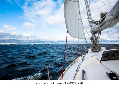Winter sailing. A view from the yacht's deck to the bow. Baltic sea, Latvia