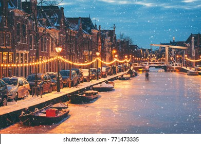 Winter scene in Alkmaar Netherlands with natural ice and falling snow