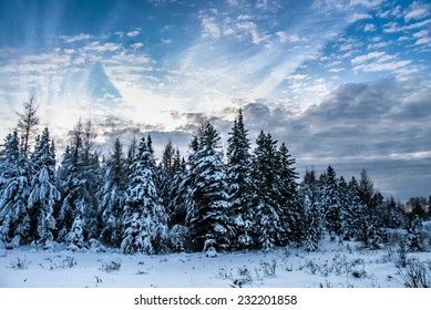 winter scene with beautiful cloudscape in rural country of Quebec, Canada