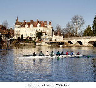 Winter scene of an Historic Road Bridge over the River Thames in England with a  rowing boat in the foreground.