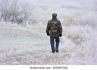Winter scene in Lithuania. The farmer  walking around his farm.