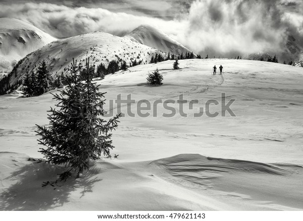 Winter scene of man in the mountains - Low Tatras - Slovak Republic.