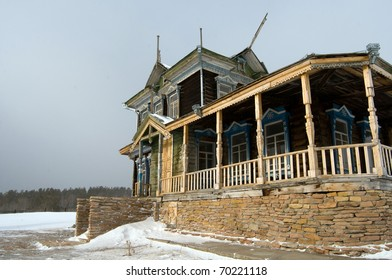Winter scene in mountains. Old house and snow