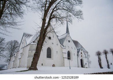 Winter scene of a rural church in the Village of Kiplev, Danmark
