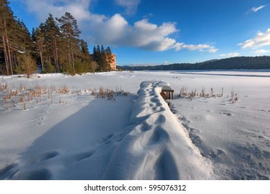 Winter scene. Shiroka Polyana Dam in a sunny winter day. Snowy fairytale in Bulgaria.