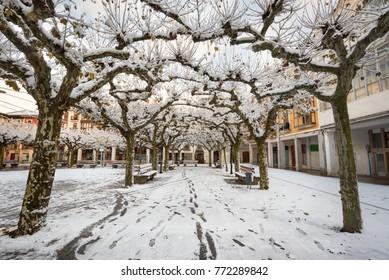 Winter scene of a snowed cityscape landscape of the ancient village of Briviesca in Burgos Province, Castilla y Leon, Spain.