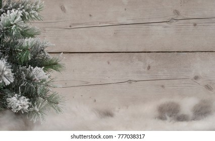 winter scenery background, with sheepskin, snowy tree and weathered wood backdrop