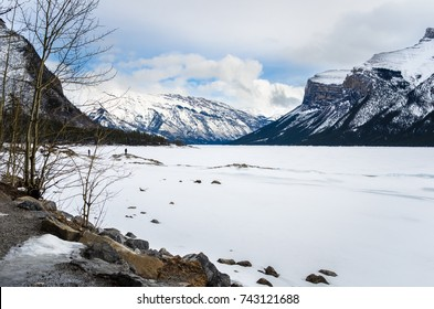 Winter Scenery in Banff National Park with a Frozen Lake and Snow Capped Mountains