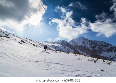 Winter scenery in the mountains with majestic alpine peaks and deep snow cover