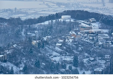 Winter scenery with residential district on the hills near Brasov city, Romania.