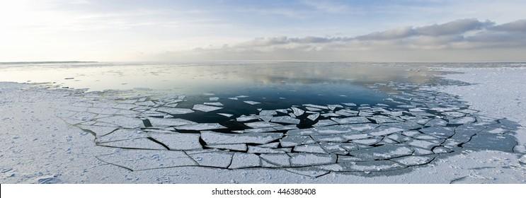 winter sea bay with broken ice