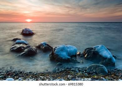 Winter sea coast at sunset. Far East of Russia.