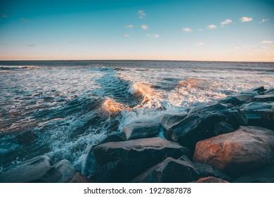The winter sea in Montauk, Long Island, the sun shines beautifully at sunrise