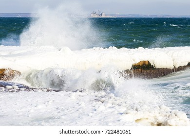Winter seascape. Snow, ice huge waves beating against the shore and freezes. Natural disaster in form of storms and severe frosts led to icing of the black sea coast near Odessa.