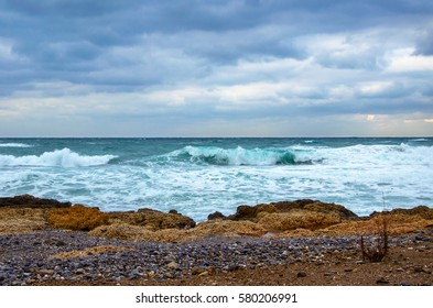 Winter seascape with waves and clouds, Crete, Greece.