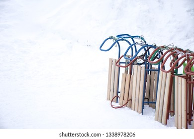 Winter season concept. Many sledges ready for fun snow day
