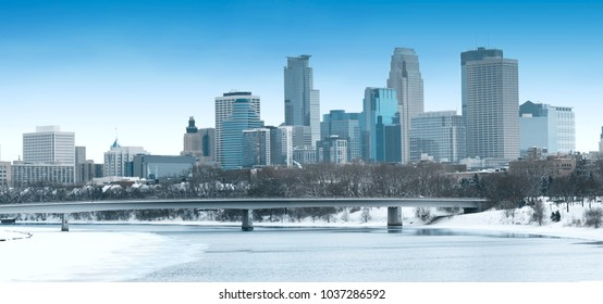 Winter season Downtown Minneapolis and Frozen  Mississippi River Panorama
