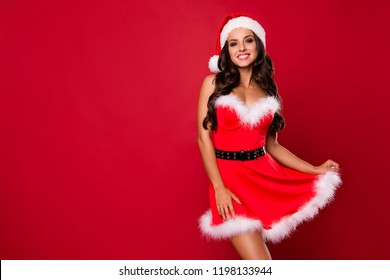 Winter season eve night celebration. Flirt, flirty, coquet, romance, affectionate brunette lady with curly wave modern hairdo look at camera isolated on shine red background with copy space for text