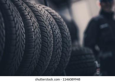 Winter Season Tire Tread. Brand New Car Tires on the Shelf.