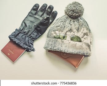 winter season travel flat lay concept from  winter cloth item and passport look like human say hello put on isolated white background