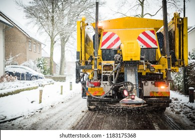 Winter service truck or spreading salt and sand on the road surface to prevent icing