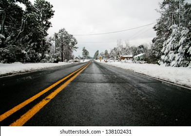 Winter setting with road with melting snow