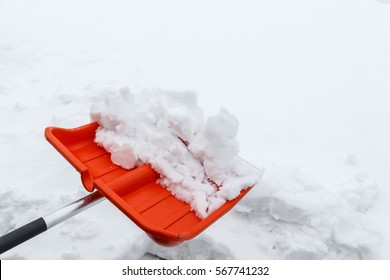 Winter shoveling. Removing snow after blizzard. Shovel which cleaning snow.