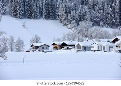 The winter ski chalet and cabin in snow mountain landscape in Austria, Europe. - Shutterstock ID 1296394522