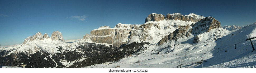 Winter ski panorama in the Alps. Skiers and slopes in Tirol, Italy.