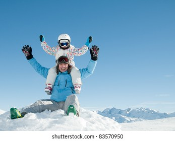 Winter, ski, sun and fun - happy family in winter resort (space for text)