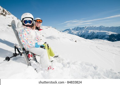 Winter, ski vacation - skiers resting on the ski (copy space)