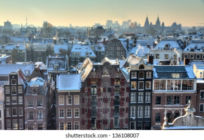Winter skyline of Amsterdam, the Netherlands, with snow on the rooftops. Looking towards the south with the Rijksmuseum on the horizon