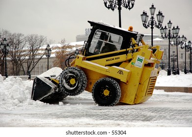 Winter snapshot snow cleaning at Manezhnaya (Manege) Square - Moscow, Russia