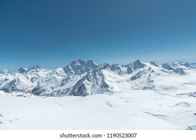 Winter snow covered mountain peaks in Caucasus. Great place for winter sports - Shutterstock ID 1190523007