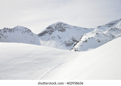 Winter snow covered mountain peaks in Europe