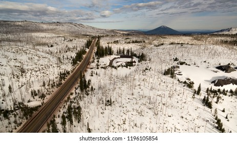 Winter snow covers the ground around Oregon highway 20 headed to Black Butte Mountain