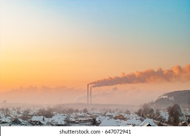 Winter snow. Early morning. Dense smoke pollutes the air. Kemerovo. Siberia. Russia.