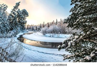 Winter snow forest river landscape. Forest river reflection in winter snow forest panorama. Winter snow forest river view