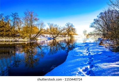 Winter snow forest river landscape. Winter river water reflection panorama. Winter snow river reflection view