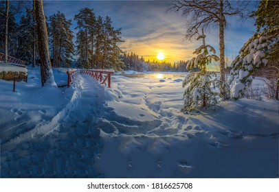 Winter snow forest trail at sunset. Sunset winter snow forest trail. Winter sunset snow scene. Winter snow scene at sunset forest
