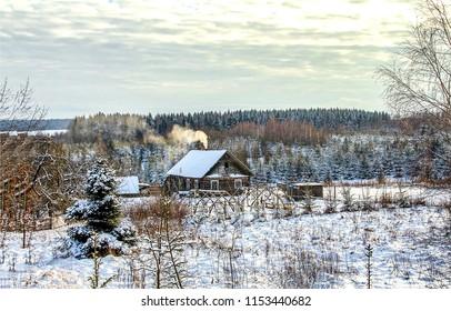 Winter snow forest village landscape. Russian winter snow forest village view. Winter snow forest village in Russia